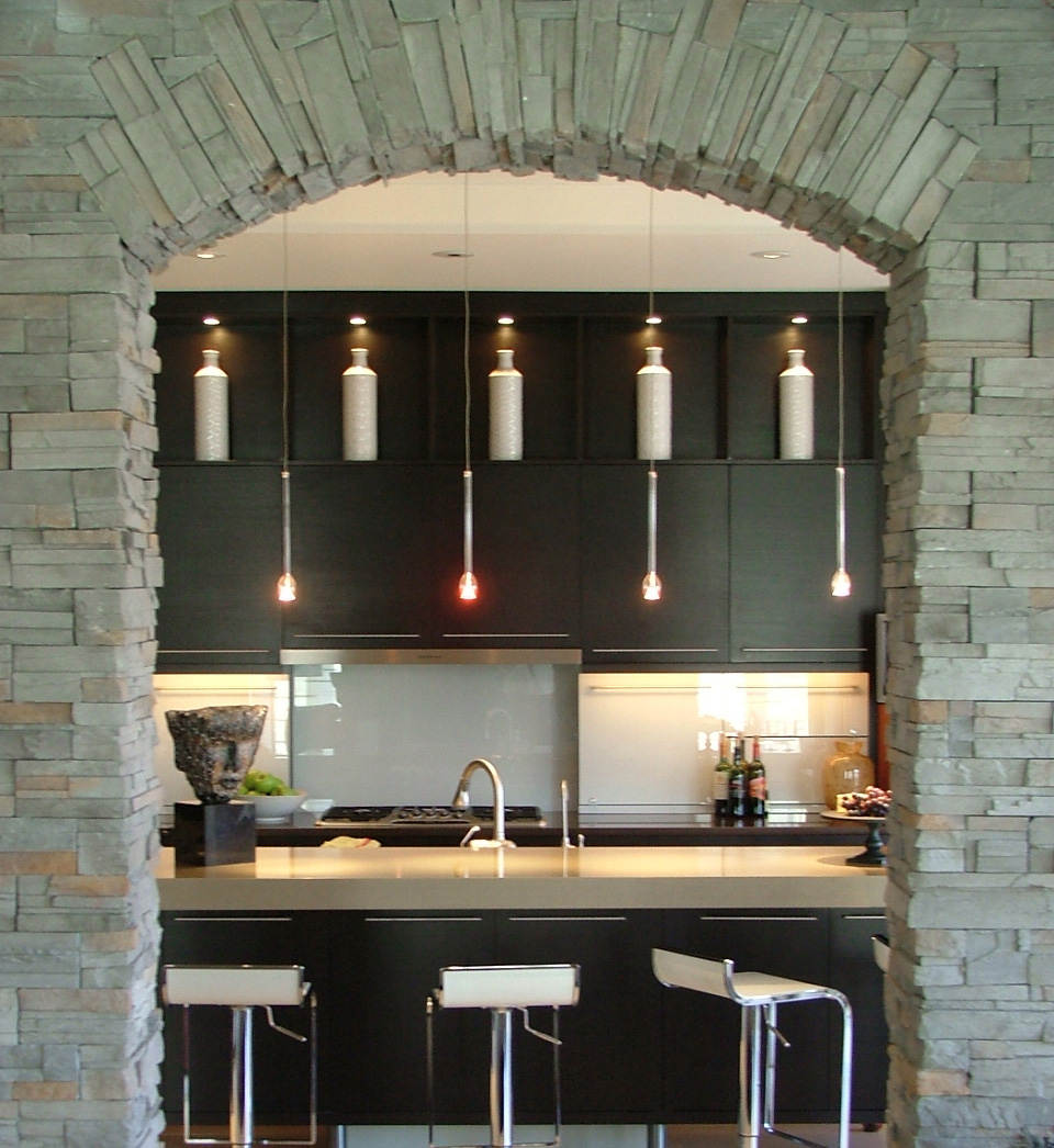 Contemporary kitchen design with glass pendant lights over the island.