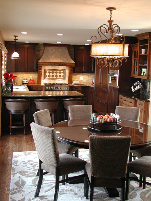 Traditional kitchen design with a chandelier over the dining table.
