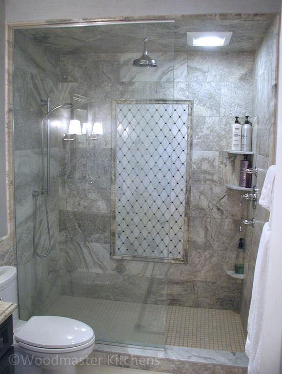 Bathroom design featuring a large shower with corner built-in shelves.