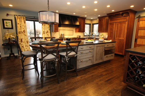 Kitchen design with an island featuring a quartz countertop and a wooden tabletop.