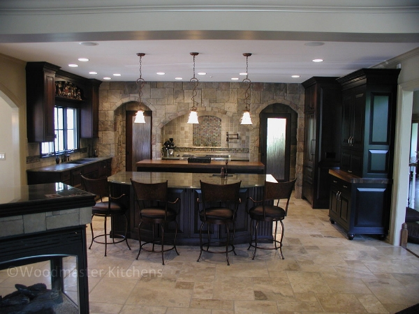 Kitchen design with two islands to separate distinct entertainment and work zones.