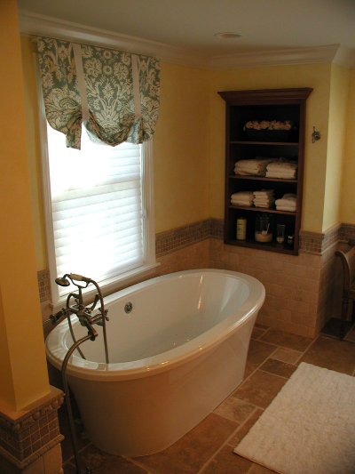 Traditional bathroom design with freestanding tub and textured tiles.