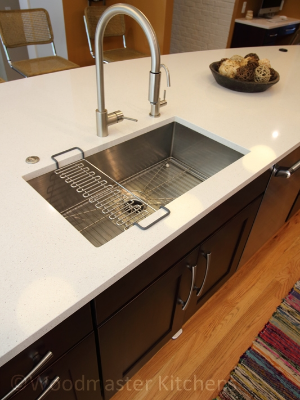 Kitchen design with a stainless steel undermount sink.