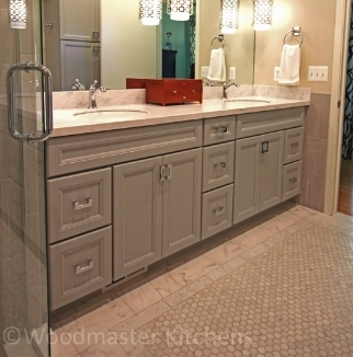 Bathroom design with a rug design Carrera marble floor and engineered quartz countertop.