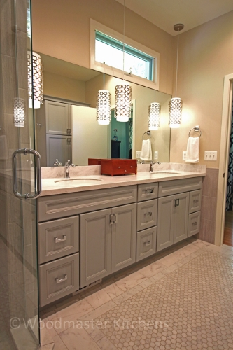 Bathroom design with a large vanity and two sinks.