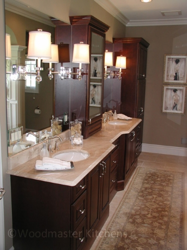 Bathroom design with vanity featuring a tower cabinet.