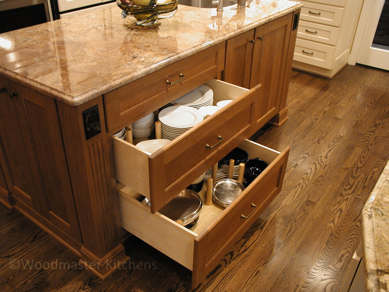Kitchen drawers with peg system for storing crockery.