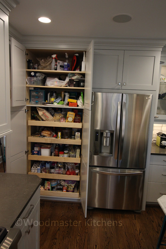 Kitchen design with a pantry with pull out shelves.