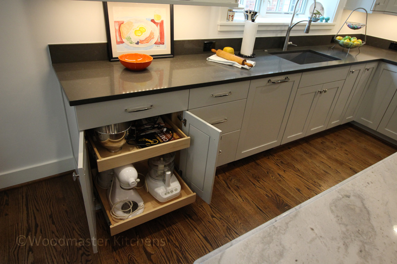 Kitchen design with pull out shelves for small appliances.
