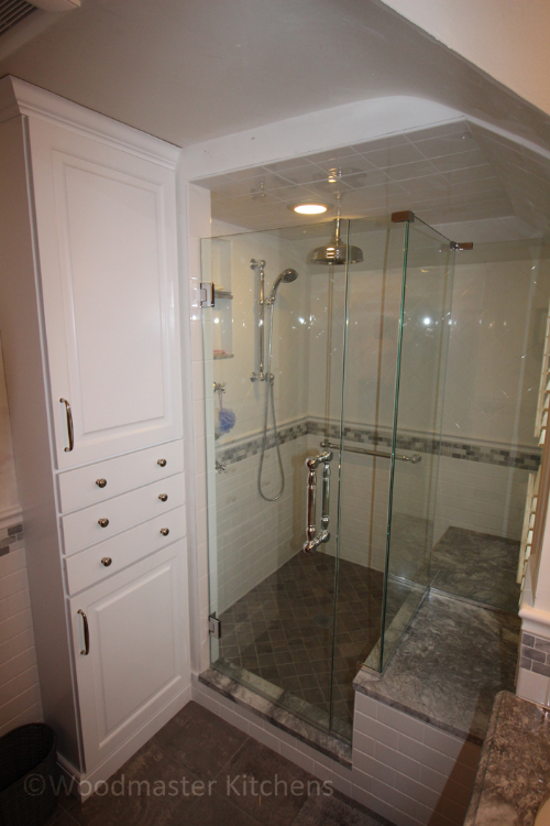 Bathroom design with frameless glass shower enclosure.