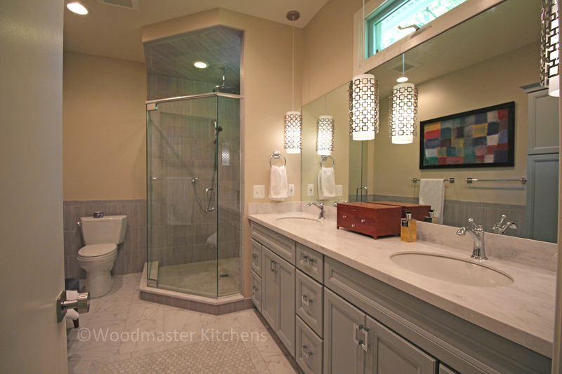 Contemporary bathroom design with double sink vanity and large corner shower.