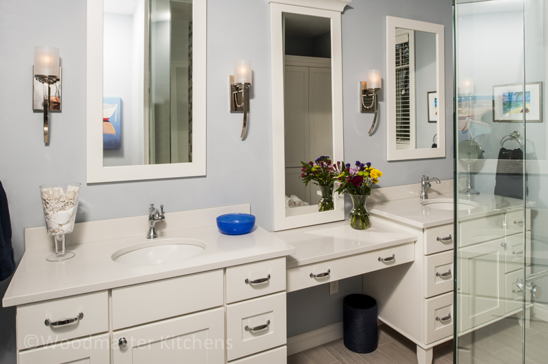 Bathroom design with a double vanity and make up vanity.
