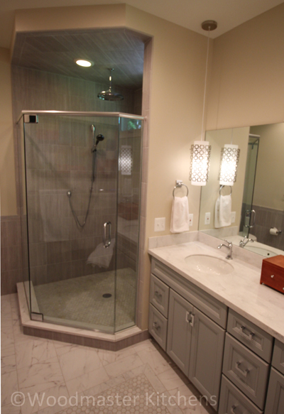 Master bath design with double vanity and shower with rainfall and handheld showerheads
