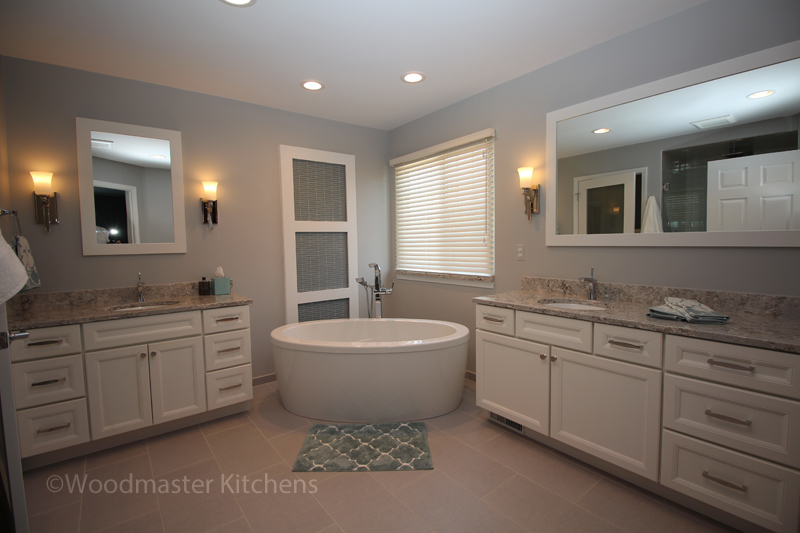 Bathroom design with freestanding tub and two vanity cabinets