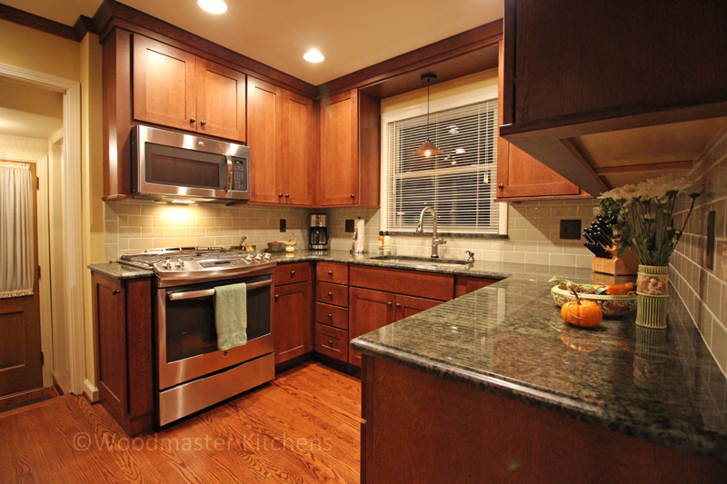 Kitchen design with granite countertop.