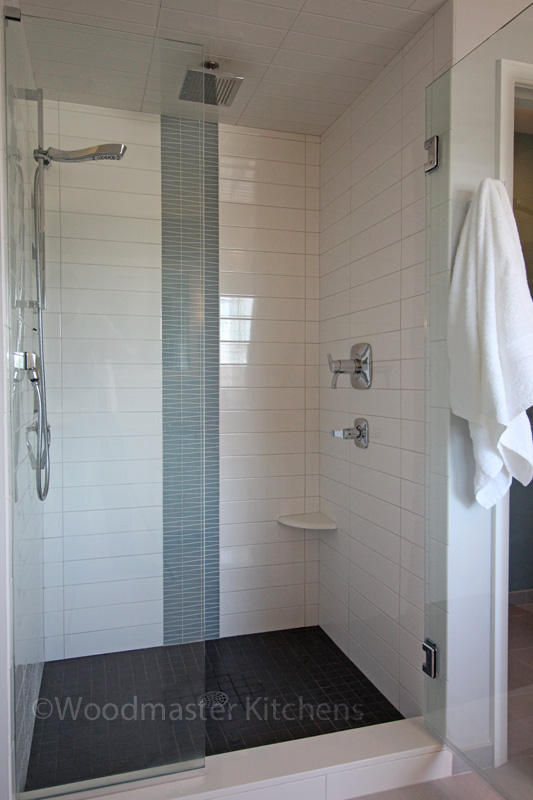 Bathroom design with corner storage shelf.