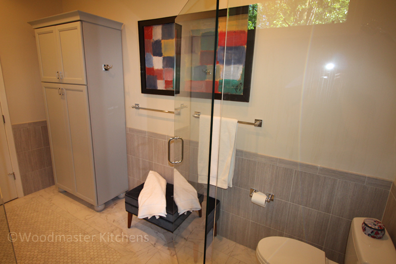 Bathroom design with towel bar and hooks.