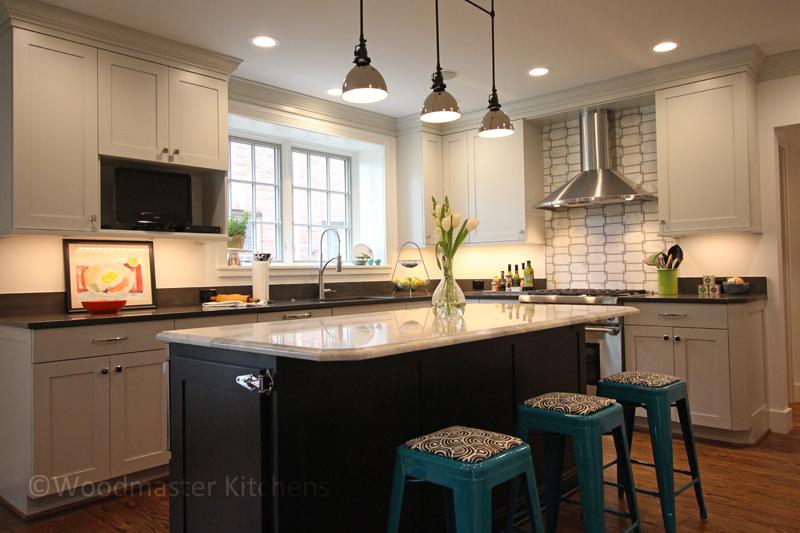 Kitchen design with colored barstools and textured tile backsplash.