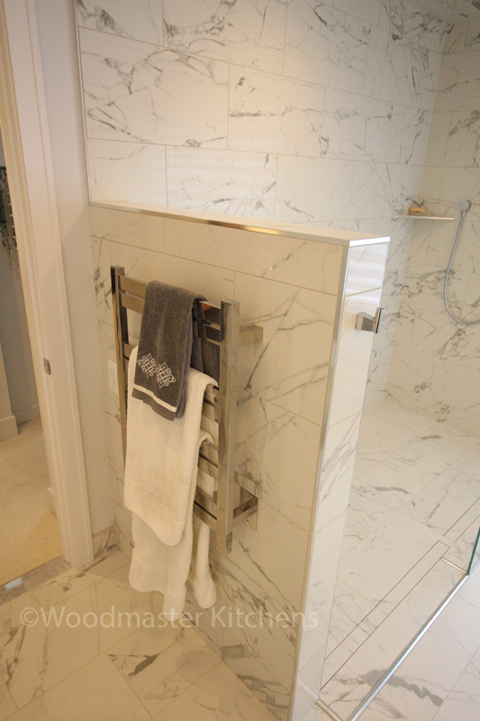 Bathroom design with radiator towel warmer.