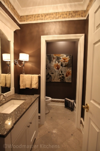 Bathroom design with dark color scheme.