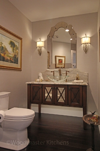 Powder room design with furniture style vanity.