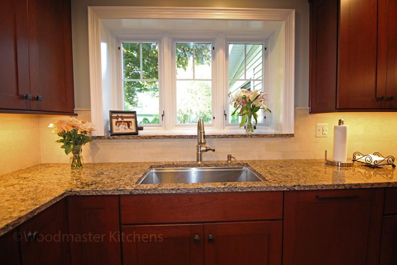 Kitchen sink facing a window.