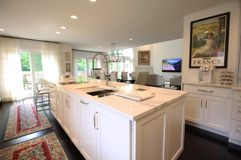 Kitchen sink facing dining and living room.