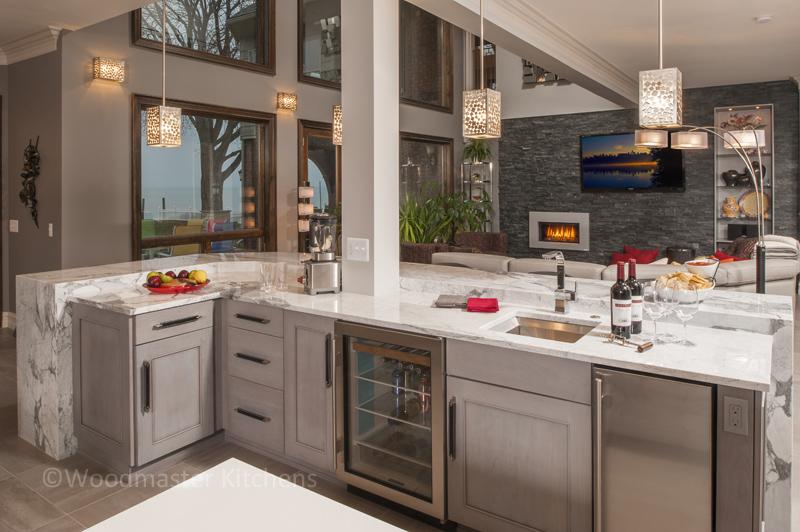 Kitchen design with beverage bar sink.