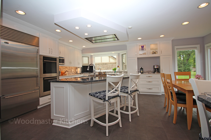 White kitchen cabinets with gray floor and walls
