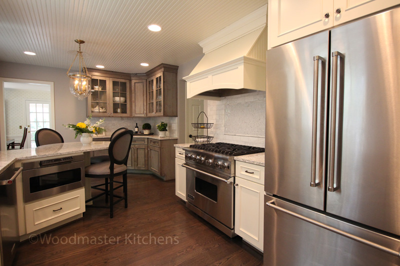 White and gray kitchen cabinets with wood floor