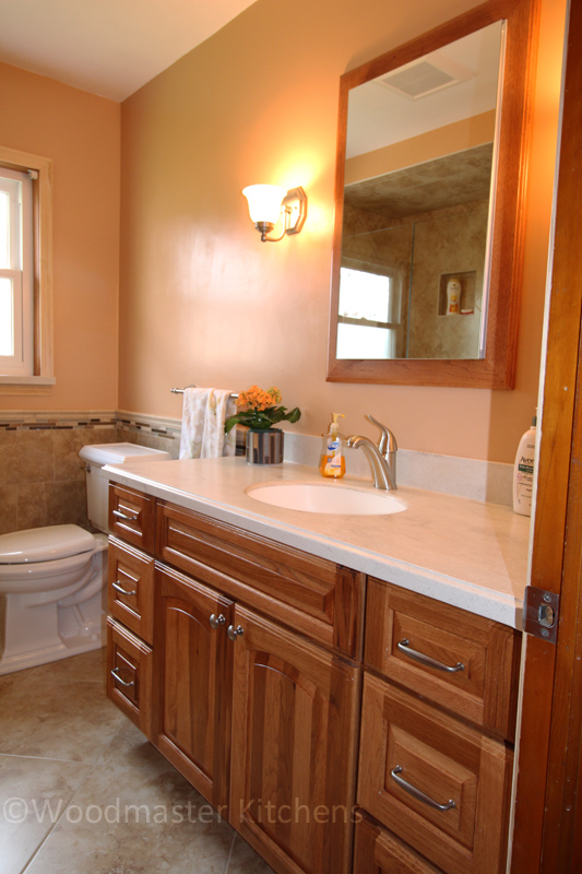 Traditional bathroom design with wood tone vanity.
