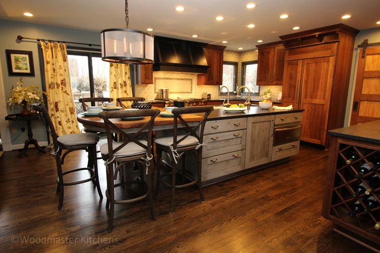 Traditional kitchen design with wood tabletop island and large drum shade chandelier