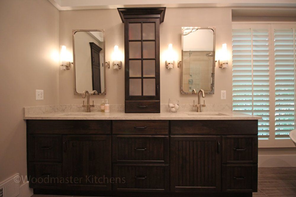 Bath design with dark wood vanity