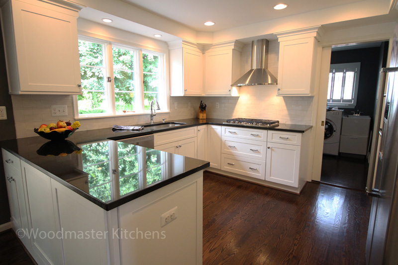 white kitchen design with dark gray engineered quartz countertop