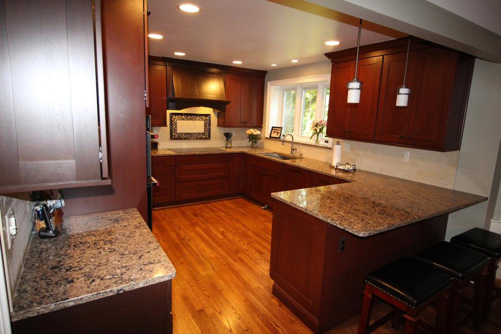 Kitchen design with dark wood cabinets