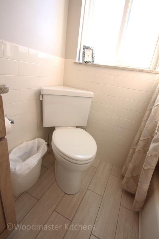 Bathroom design with a corner toilet