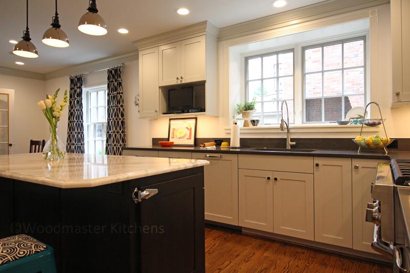 white kitchen design with dark wood island