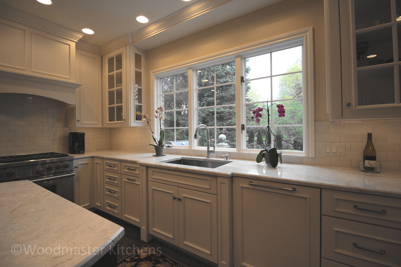 white kitchen design with view to garden