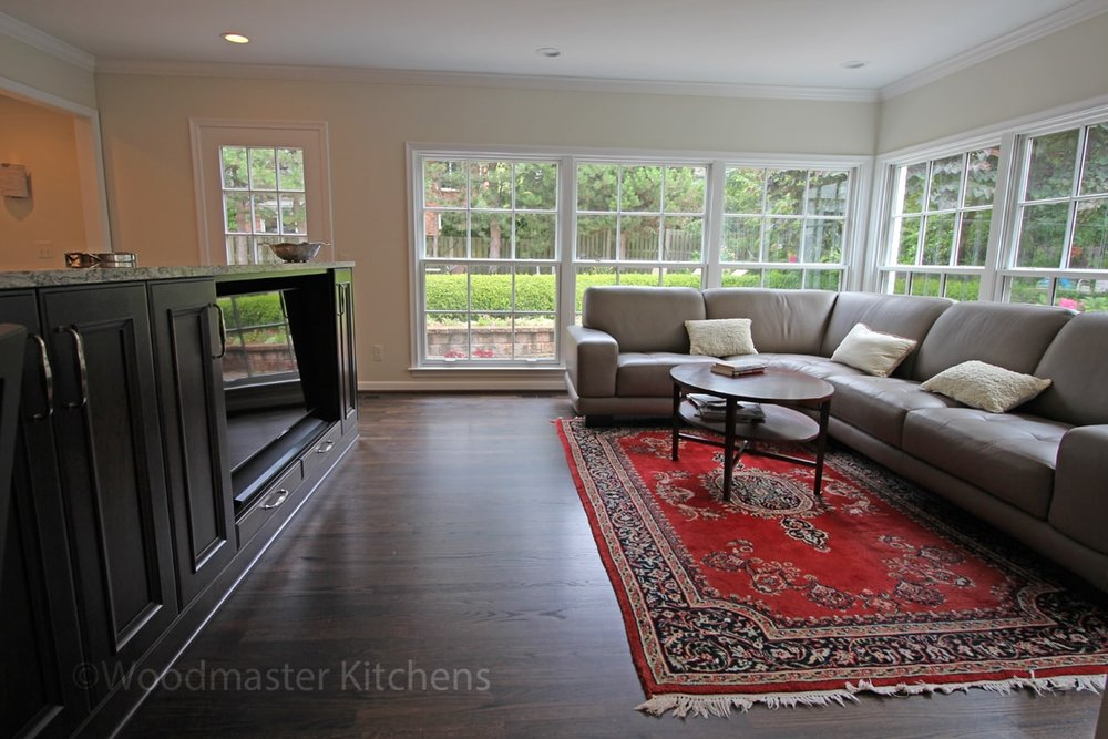 Open plan kitchen design with wood floors