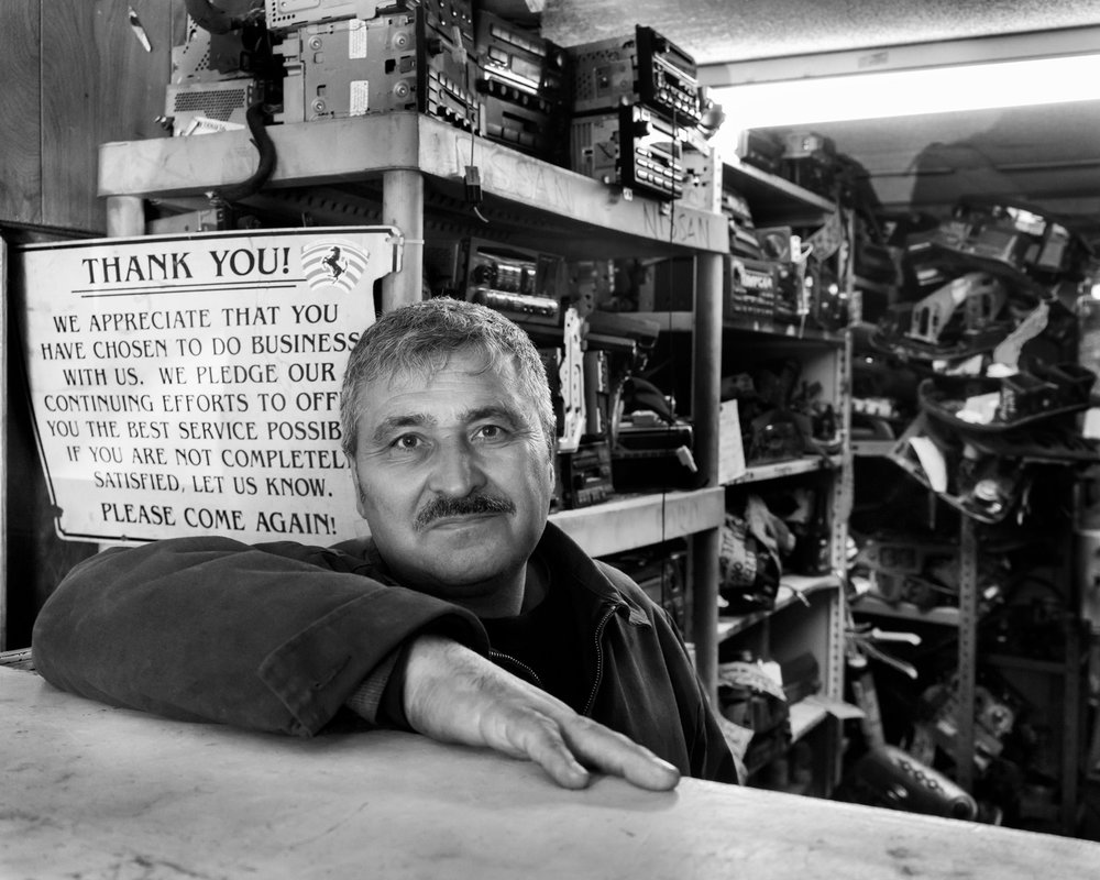 Ali behind the counter in his shop