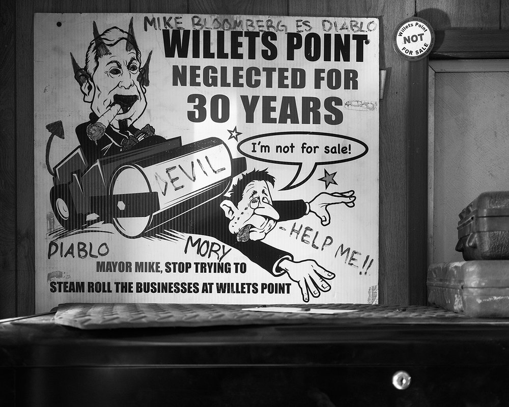 """A sign in Ali's shop. I now own the """"Willets Point NOT For Sale"""" button in the photo"""