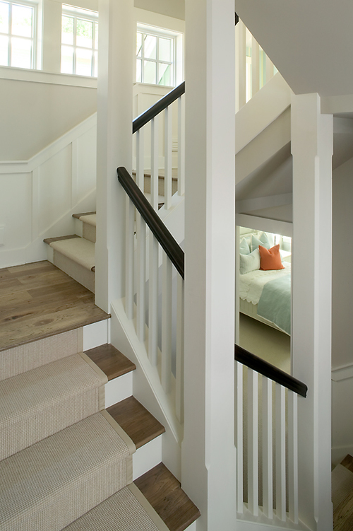 Check out this beautiful, albeit not inexpensive, fix. Wood treads, painted rail, tailored spindles, lovely neutral runner. Sigh. (Photo courtesy of  Visbeen  Architects: Well done, Visbeen.)