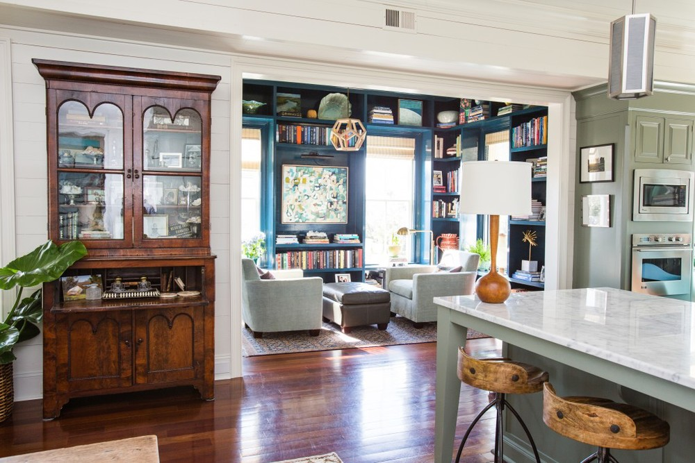 What color can I paint my cabinets? How dark is too dark for a library? How do I mix old with new? With the guidance of an interior designer, this space combines old with new, dark and light...creating a welcoming transitional space. Photo courtesy of  Cortney Bishop .
