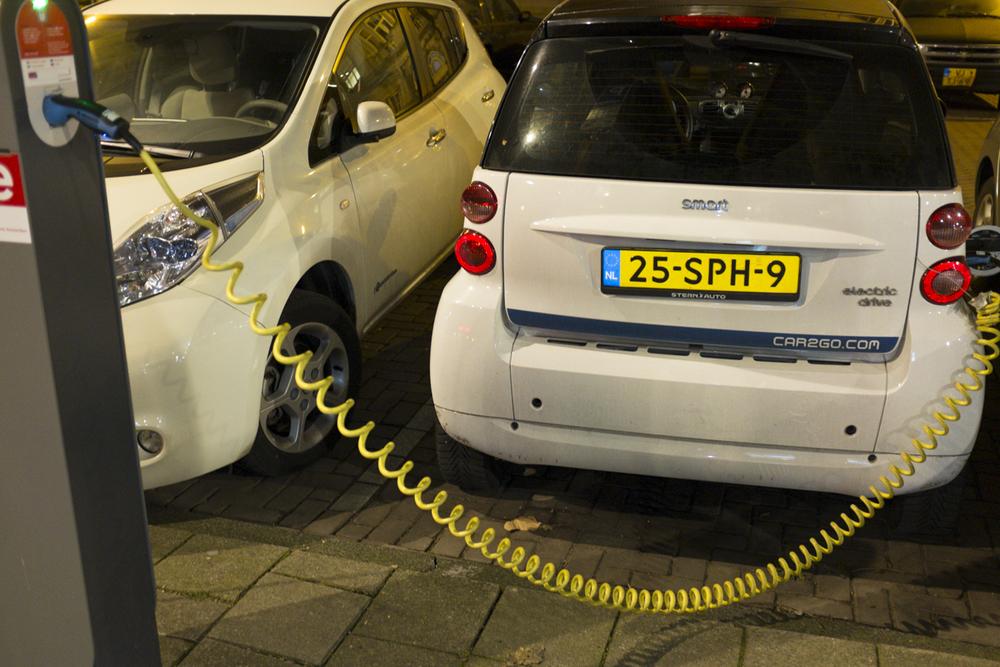 Weird small electric car charging mechanism.