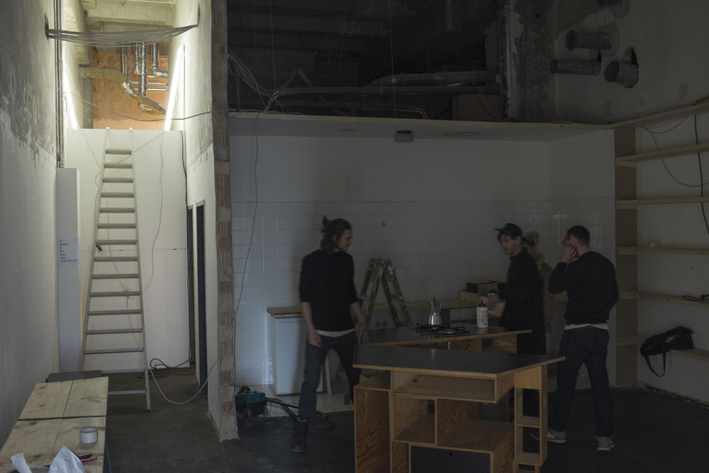 Dudes setting up the kitchen. The found this place for a crazy deal and have started rennovating and tearing out walls and ceilings.