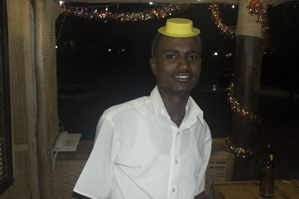 We took the canoe out at night and crashed the African Lodge's party. This was the bartender.