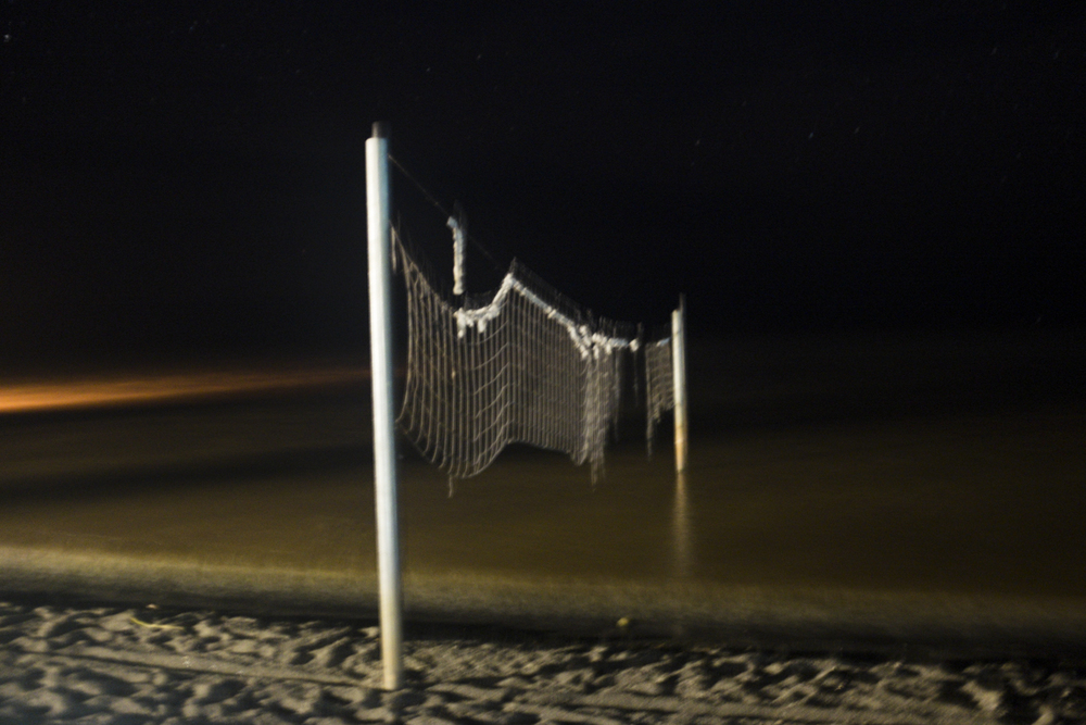 Creepy volleyball net at night.