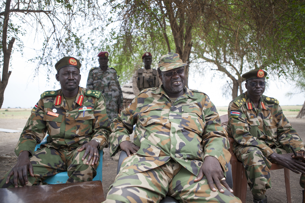 Riek Machar, leader of the South Sudan Rebel Army (SPLA) sits with top ranking officials in a camp near the border of Ethiopia.