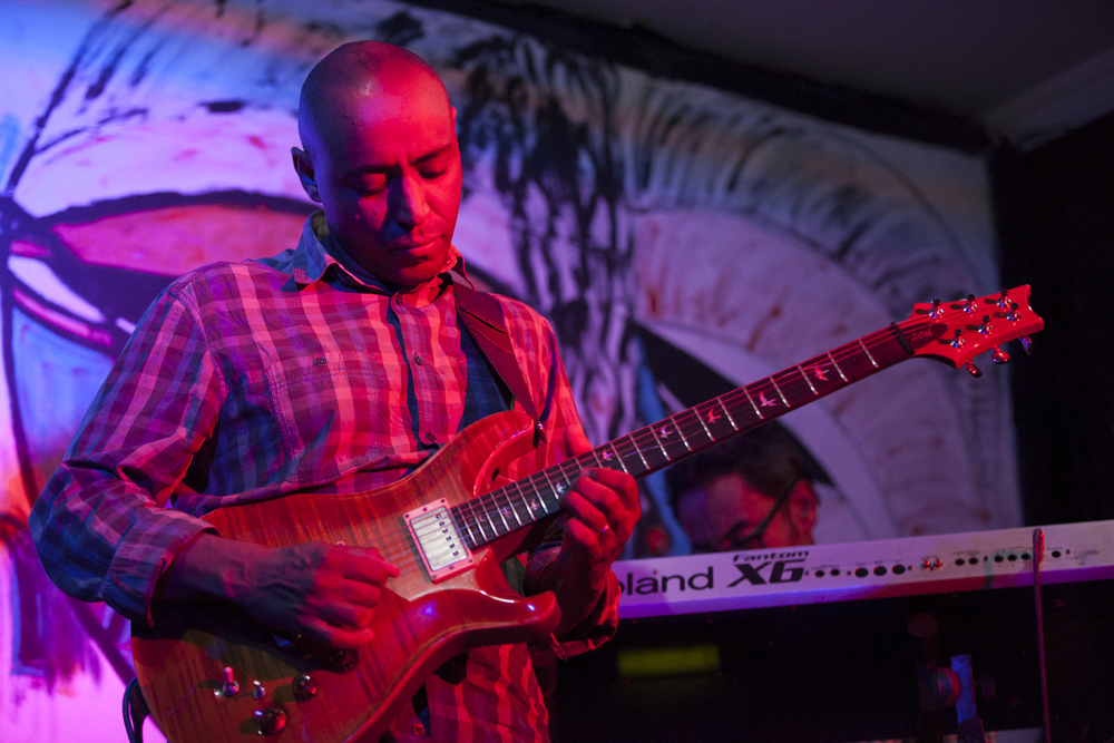 Girum Mezmur, Ethiopian guitarist, and part owner of Jazzamba Club, is pictured playing during the Jam session at Mama's Kitchen in Addis Ababa on 16 Feb 2015.  Even before the destruction of Jazzamba club, Ethiopian musicians were spreading out to clubs and bars around town to play live music. AFP PHOTO / Zacharias Abubeker