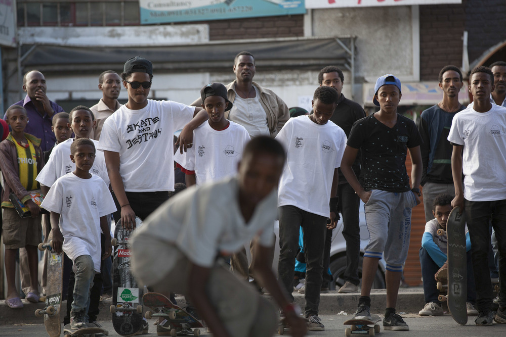 An young Ethiopian skateboarder, part of the Ethiopia Skate organization, is pictured mid-trick in the Bole area of Addis Ababa as his fellow skater friends watch on 2 March 2015. There is a growing skateboarding movement happening in Ethiopia, being taken up by various skating groups of young people of assorted ages ranging form 7 to 22 years old. AFP Photo / Zacharias Abubeker